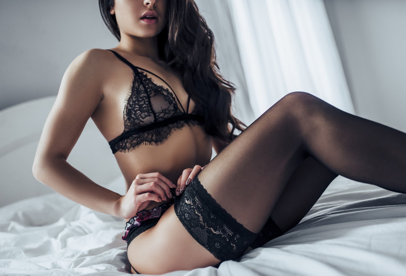 girl straightens stockings